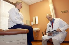 doctor sitting with patient